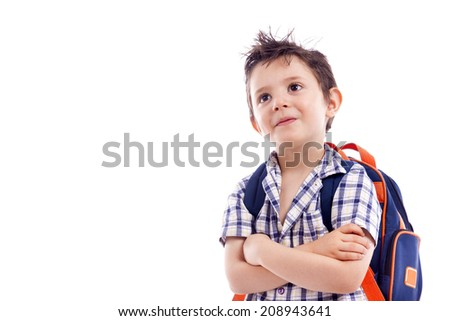 Schoolboy with backpack looking up, isolated on white background - stock photo