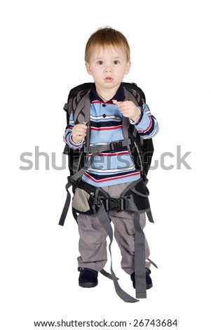 Schoolboy with backpack on a white background - stock photo