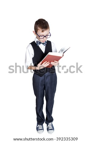 Schoolboy with book isolated on white background - stock photo