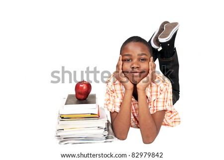 Schoolboy with books and apple - stock photo