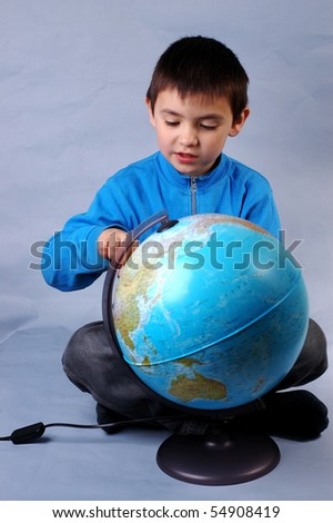 Schoolboy with globe - stock photo