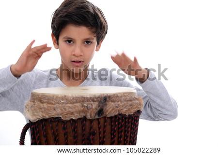 schoolboy with jumbo drum - stock photo