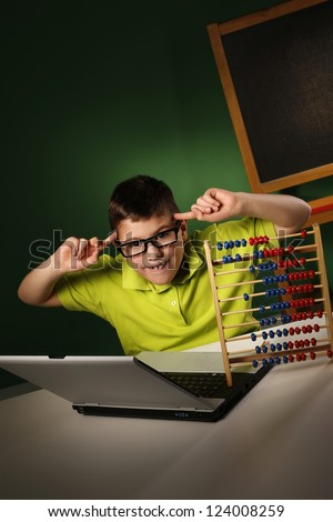 Schoolboy with modern and tradition learning tools - stock photo