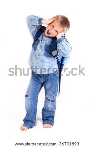 schoolboy with schoolbag - hands on his head - studio photo - stock photo