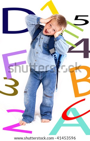 schoolboy with schoolbag - studio photo - stock photo
