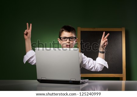Schoolboy with tradition and modern education tools - stock photo