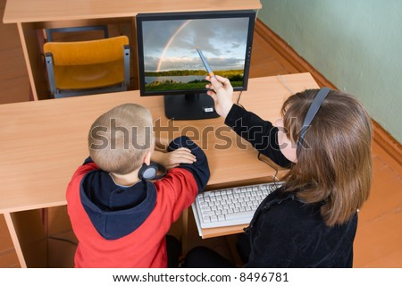 Schoolboys in a computer class work behind computers - stock photo