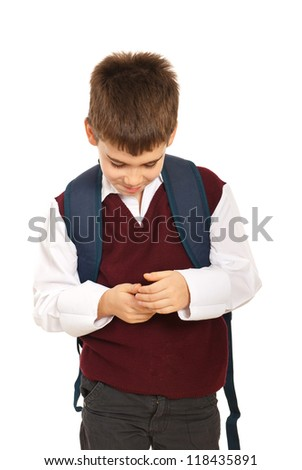 Schoolboyy hide something in his hands isolated on white background - stock photo