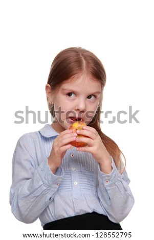 Schoolchild portrait eating an apple/Cute girl portrait eating red apple on Food and drink