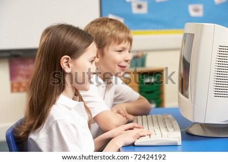Schoolchildren In IT Class Using Computer - stock photo