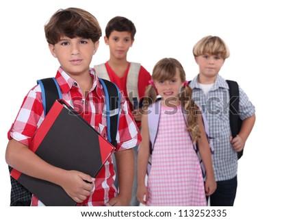 Schoolchildren with backpacks - stock photo