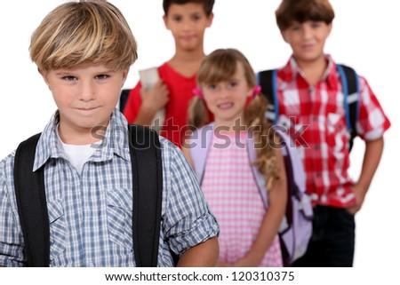 Schoolchildren with bags - stock photo
