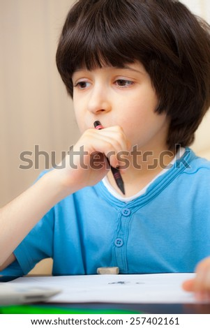 schoole boy portrait with pen - stock photo