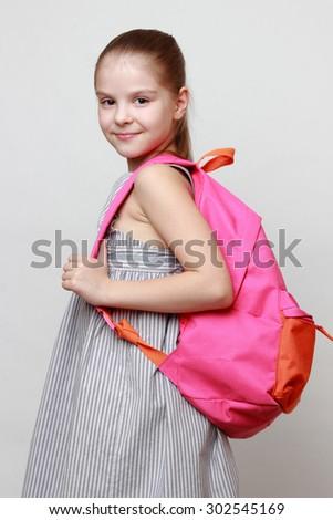 Schoolgirl and school bag - stock photo