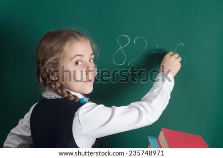 schoolgirl and school board - stock photo