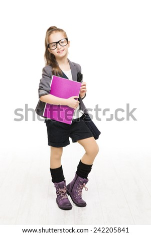 Schoolgirl child in glasses holding book. Student school girl isolated white background - stock photo