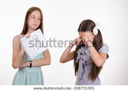Schoolgirl crying upset because of two received