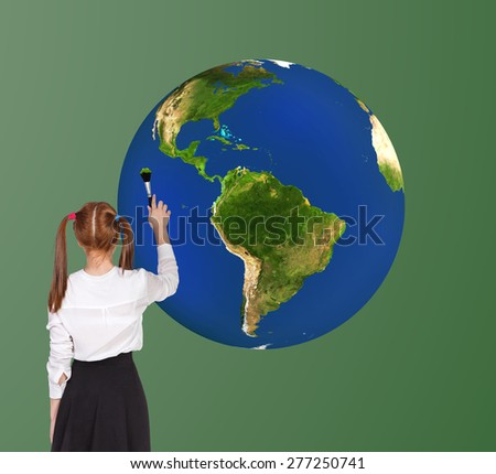 Schoolgirl drawning globe on the blackboard