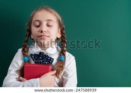 schoolgirl dream have a school board - stock photo