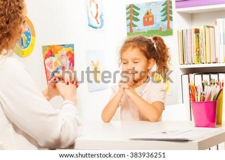 Schoolgirl exercises putting fingers with teacher - stock photo