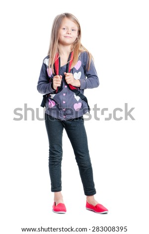 Schoolgirl. Full length of pretty little girl standing with backpack. Isolated on white. - stock photo