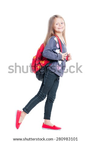 Schoolgirl. Full length of pretty little girl walking with backpack. Isolated on white. - stock photo