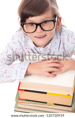 Schoolgirl holding pile of books isolated.