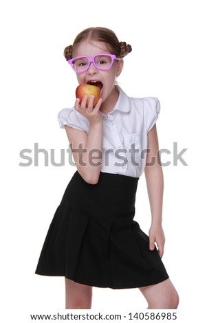 schoolgirl holding red apple on Education theme