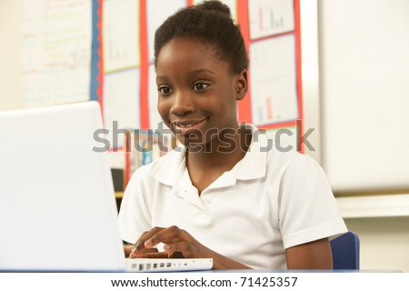 Schoolgirl In IT Class Using Computer - stock photo