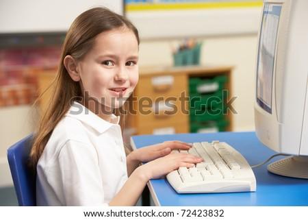 Schoolgirl In IT Class Using Computer - stock photo