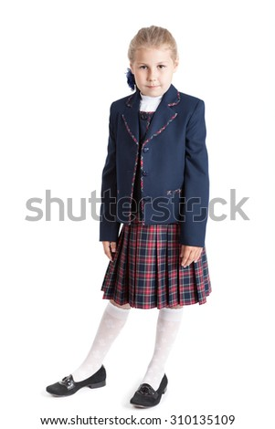 Schoolgirl in school uniform standing full length isolated on white background