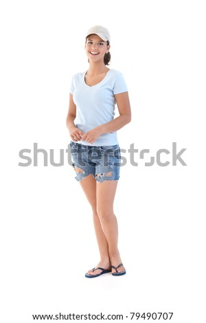 Schoolgirl in shorts at summertime, smiling, looking at camera.? - stock photo