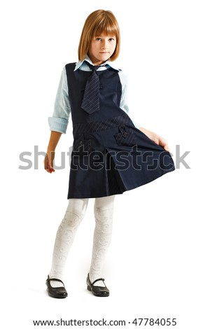 Schoolgirl in uniform on white background - stock photo