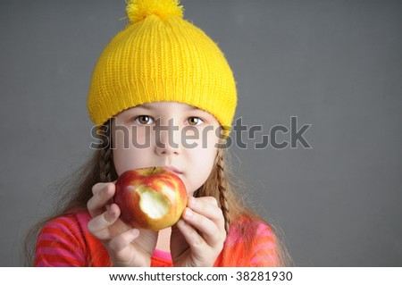 schoolgirl in yellow cap - stock photo