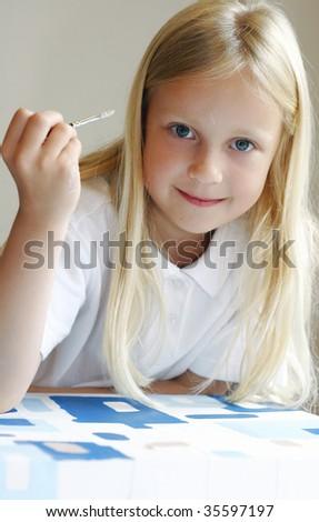 Schoolgirl painting - stock photo