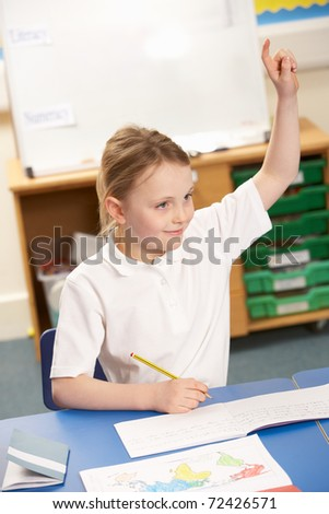 Schoolgirl Studying In Classroom - stock photo