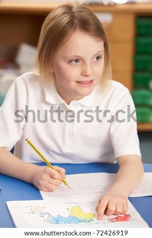 Schoolgirl Studying In Classroom - stock photo