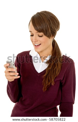 Schoolgirl using mobile phone isolated on white - stock photo