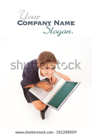 Schoolgirl with a guilty look using a laptop - stock photo