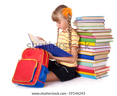 Schoolgirl with backpack reading pile of books. Isolated.