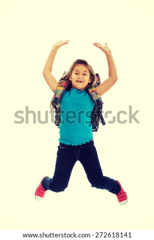 Schoolgirl with bag jumping high - stock photo
