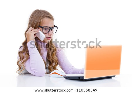 Schoolgirl with her white netbook and mobile phone - stock photo