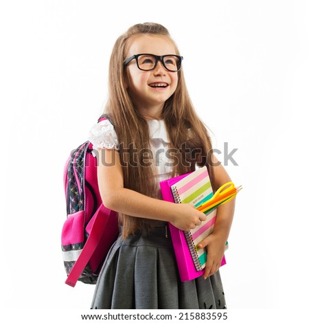 Schoolgirl with pink satchel  in glasses holding book,  isolated white background. Education and school concept - stock photo