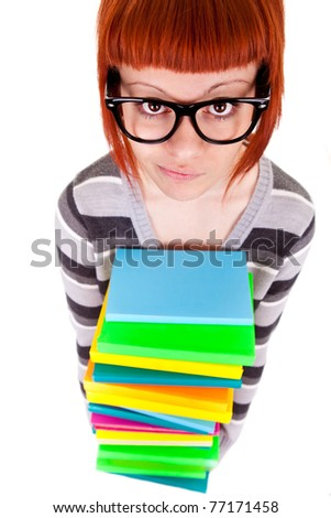 schoolgirl with red hair holding pile books ,isolated on white background, top view - stock photo
