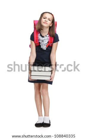 Schoolgirl with the briefcase and the pile of heavy books, isolated, white background - stock photo