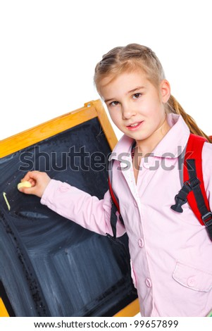 Schoolgirl writing on a blackboard, isolated on white. Vertical view - stock photo