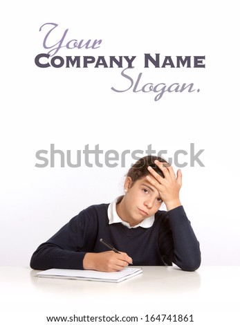 Schoolgirl writing on a notebook with an stressed expression  - stock photo