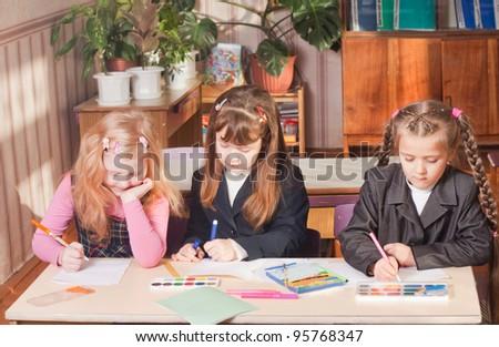 schoolgirls in classroom - stock photo