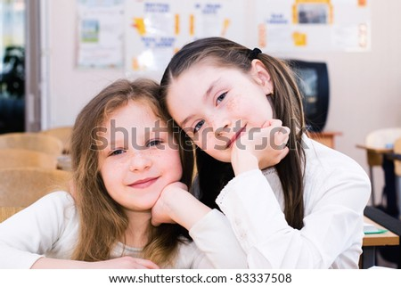 schoolgirls on the lesson in a classroom - stock photo