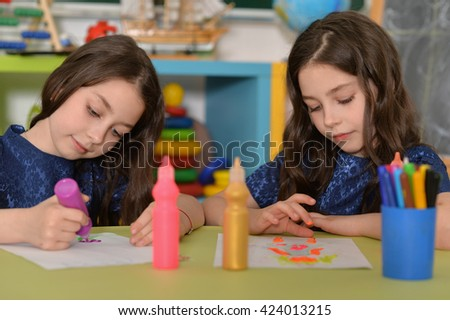 schoolgirls twins on lesson of art